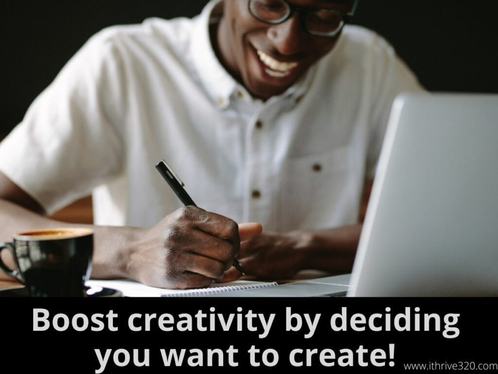 "A man writing with the caption ""Get in your creative zone by telling yourself, I wan't to get this creative project done!"""